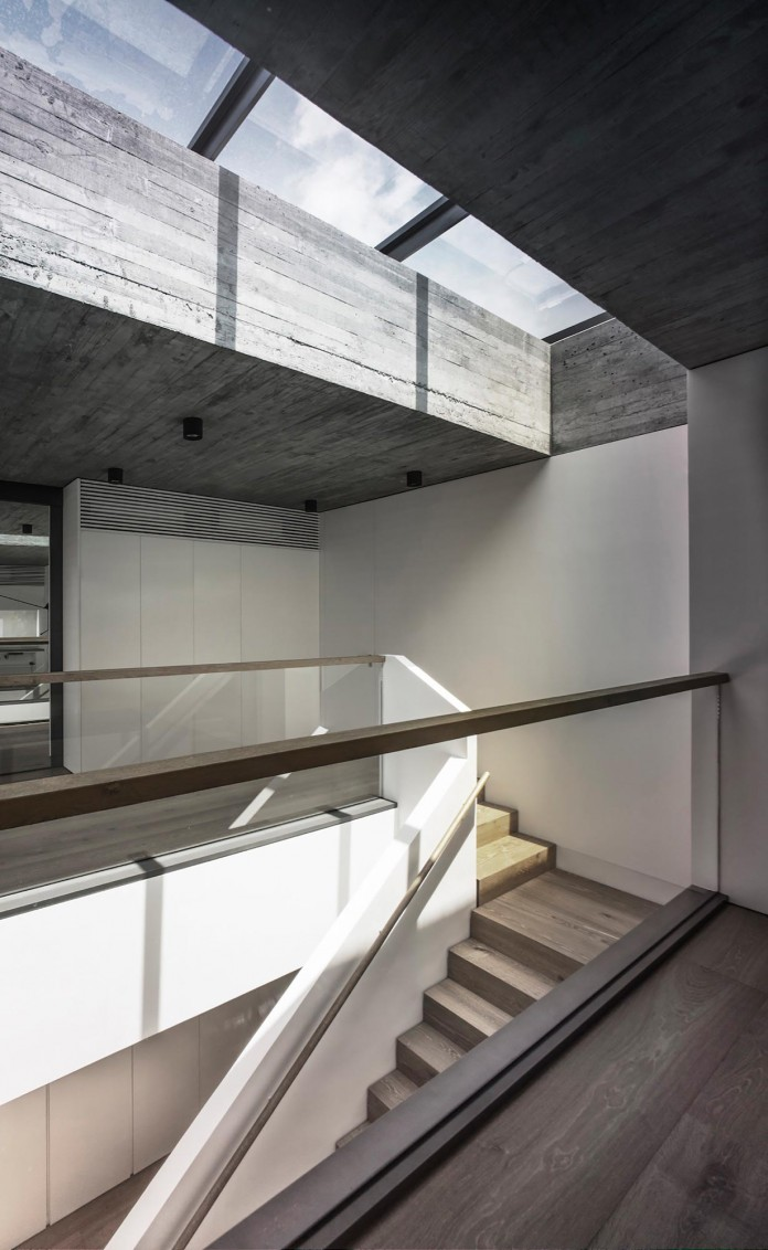 bridged-house-two-existing-houses-of-different-ages-and-styles-as-one-by-idabilly-architects-10