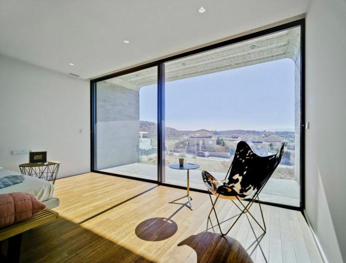 singular-crossed-house-in-la-alcayna-by-clavel-arquitectos-06