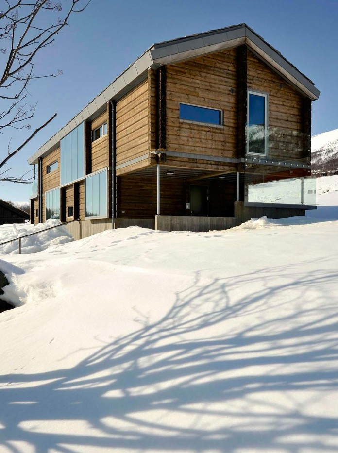 wooden-log-house-in-snowy-oppdal-norway-by-jva-02
