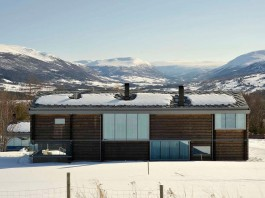 Wooden Log House in Snowy Oppdal, Norway by JVA