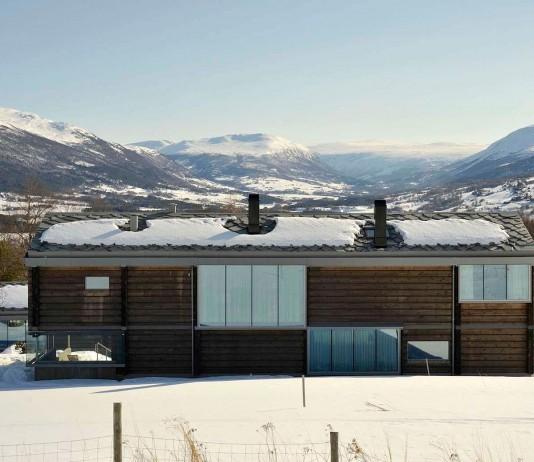 Wooden Log House in Snowy Oppdal, Norway by JVA