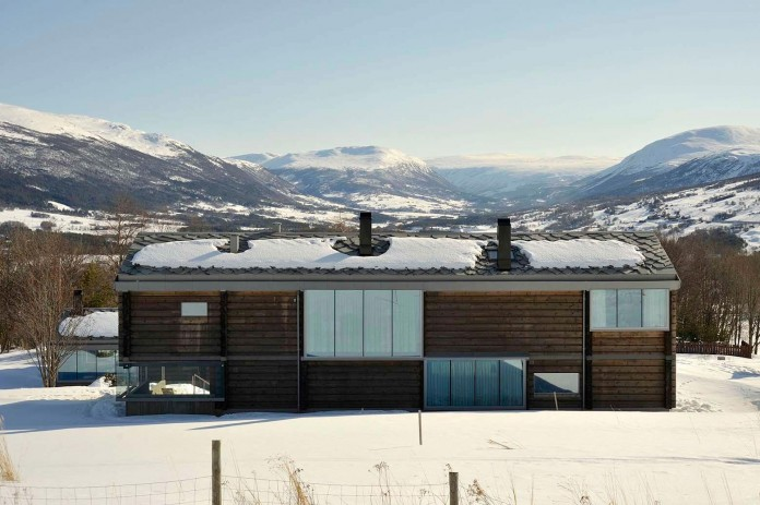 wooden-log-house-in-snowy-oppdal-norway-by-jva-04
