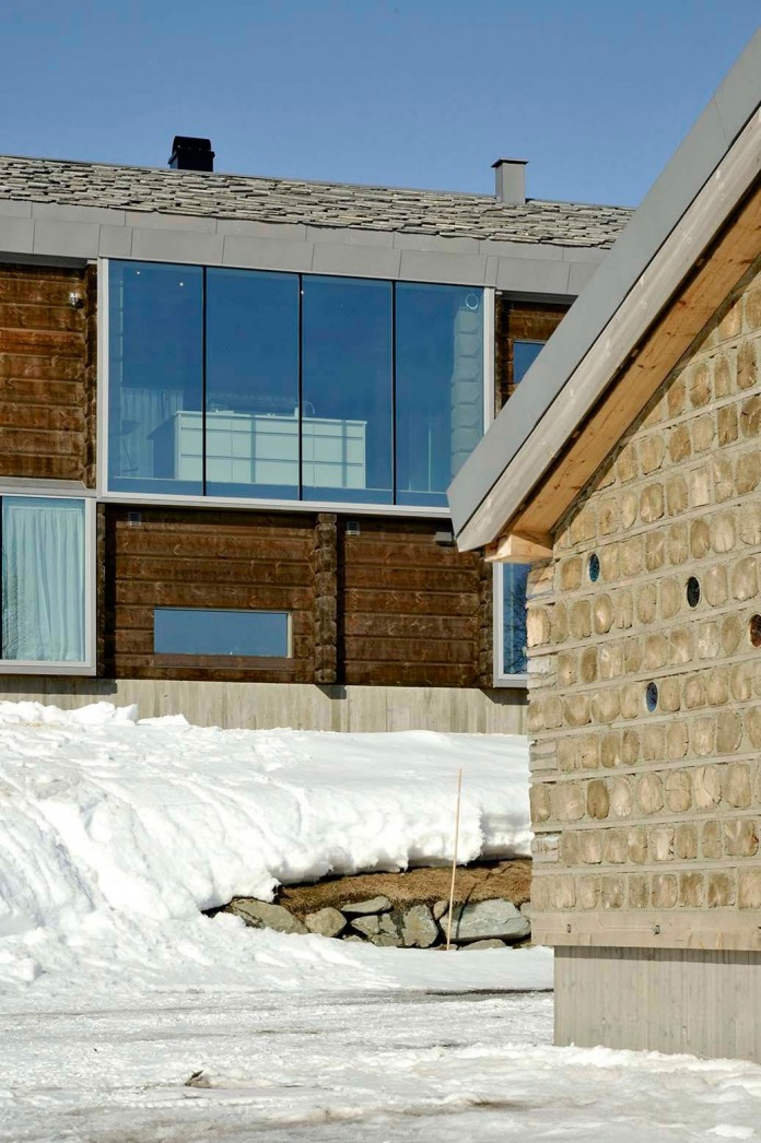 wooden-log-house-in-snowy-oppdal-norway-by-jva-05