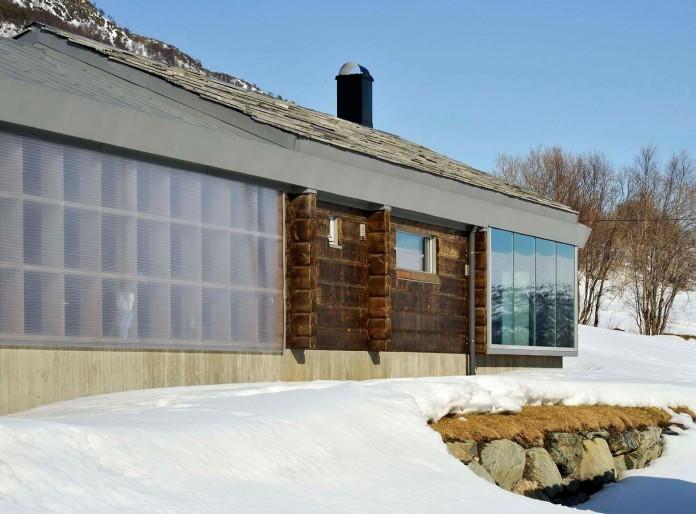 wooden-log-house-in-snowy-oppdal-norway-by-jva-06