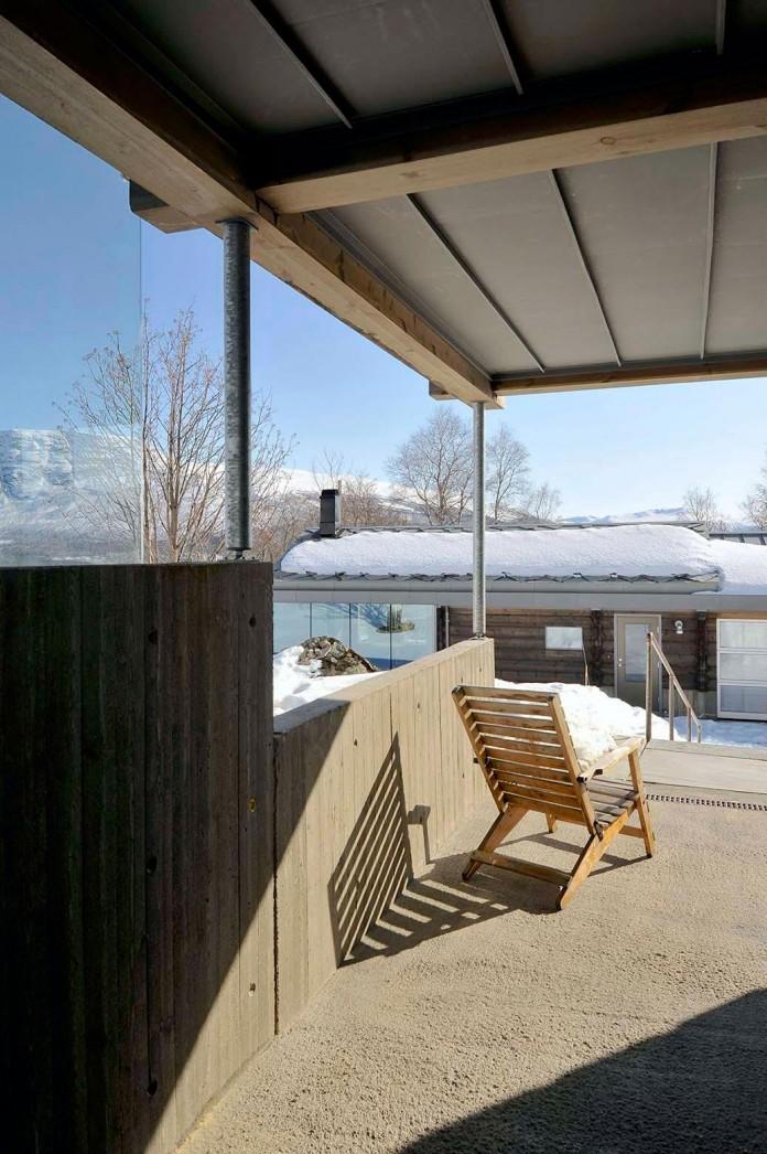 wooden-log-house-in-snowy-oppdal-norway-by-jva-08
