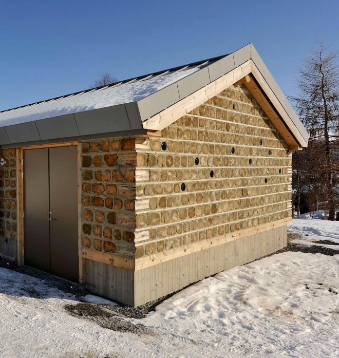 wooden-log-house-in-snowy-oppdal-norway-by-jva-09