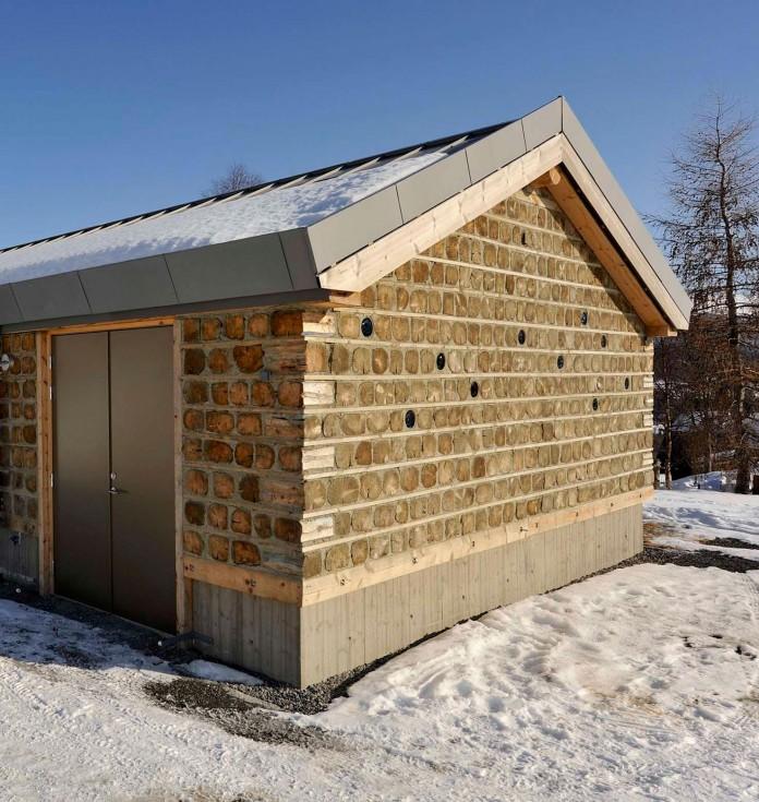 wooden-log-house-in-snowy-oppdal-norway-by-jva-09