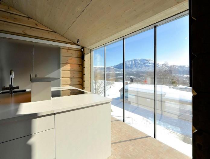 wooden-log-house-in-snowy-oppdal-norway-by-jva-12