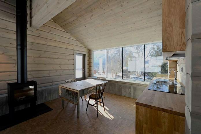 wooden-log-house-in-snowy-oppdal-norway-by-jva-13