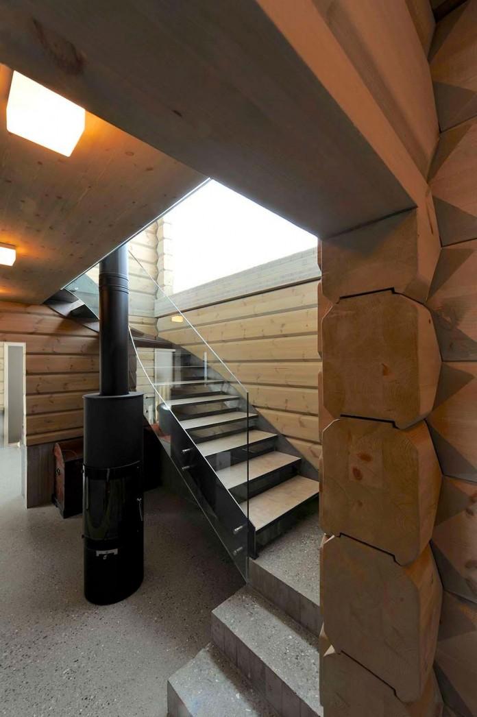 wooden-log-house-in-snowy-oppdal-norway-by-jva-14