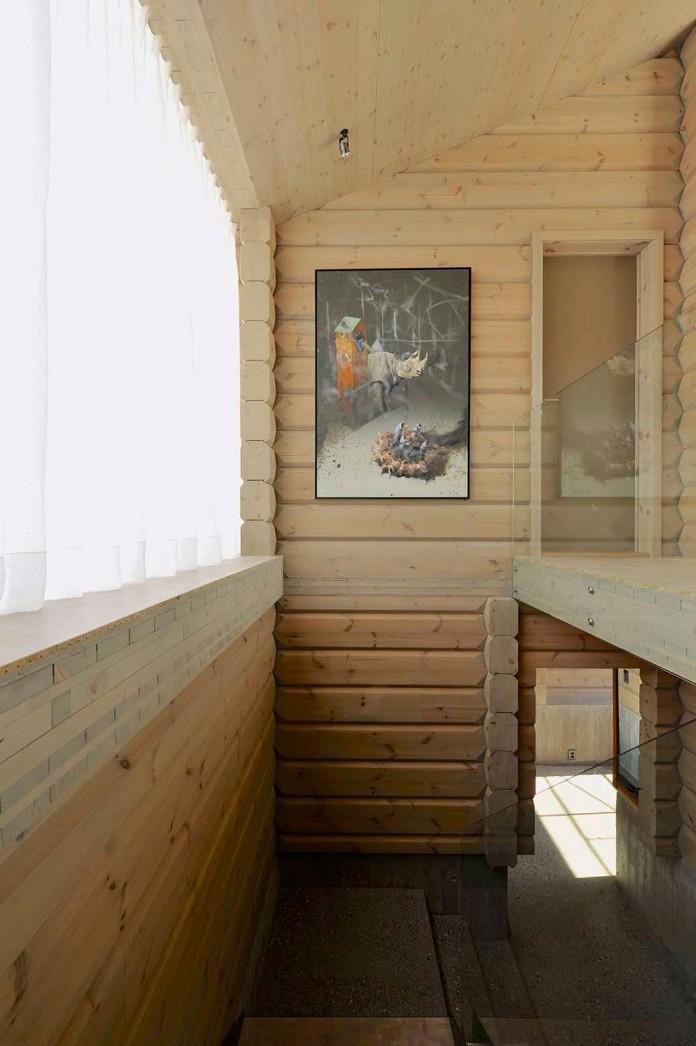 wooden-log-house-in-snowy-oppdal-norway-by-jva-16
