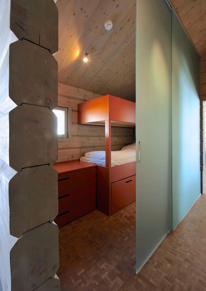 wooden-log-house-in-snowy-oppdal-norway-by-jva-18