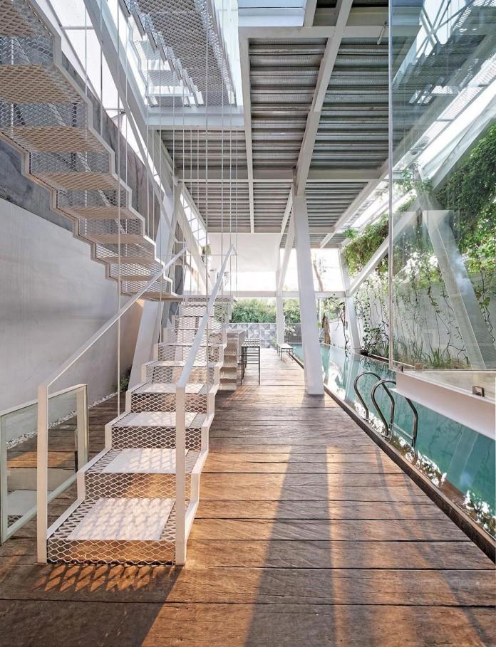 Small-Slanted-House-in-Jakarta-by-Budi-Pradono-Architects-05
