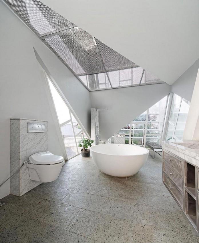 Small-Slanted-House-in-Jakarta-by-Budi-Pradono-Architects-09
