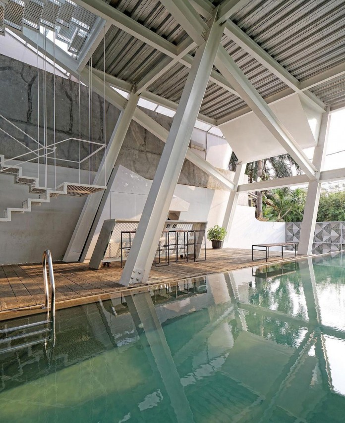 Small-Slanted-House-in-Jakarta-by-Budi-Pradono-Architects-11