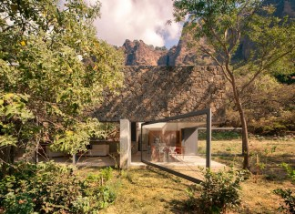 Built out of rough stone, crawls low under the trees: Casa Meztitla by EDAA