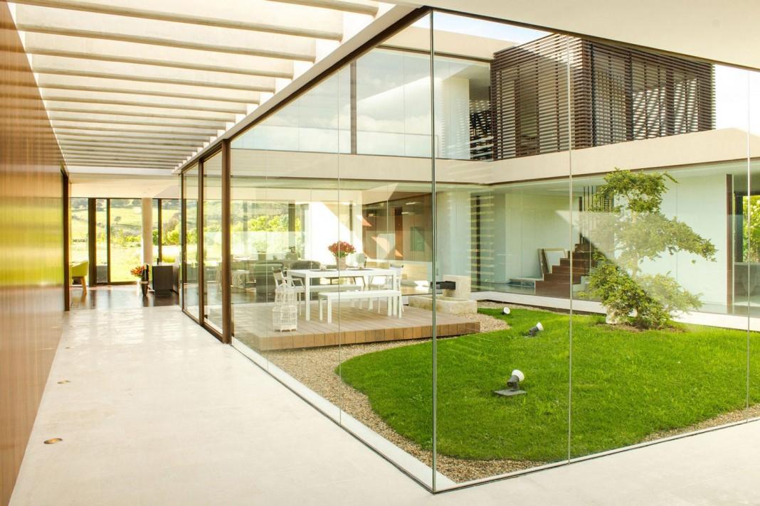 Arquitectura en Estudio design Casa 5, a contemporary home with small yard inside