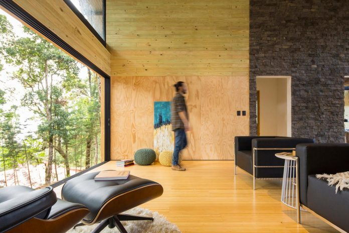 efc-contemporary-cabin-small-forest-oak-trees-designed-void-09