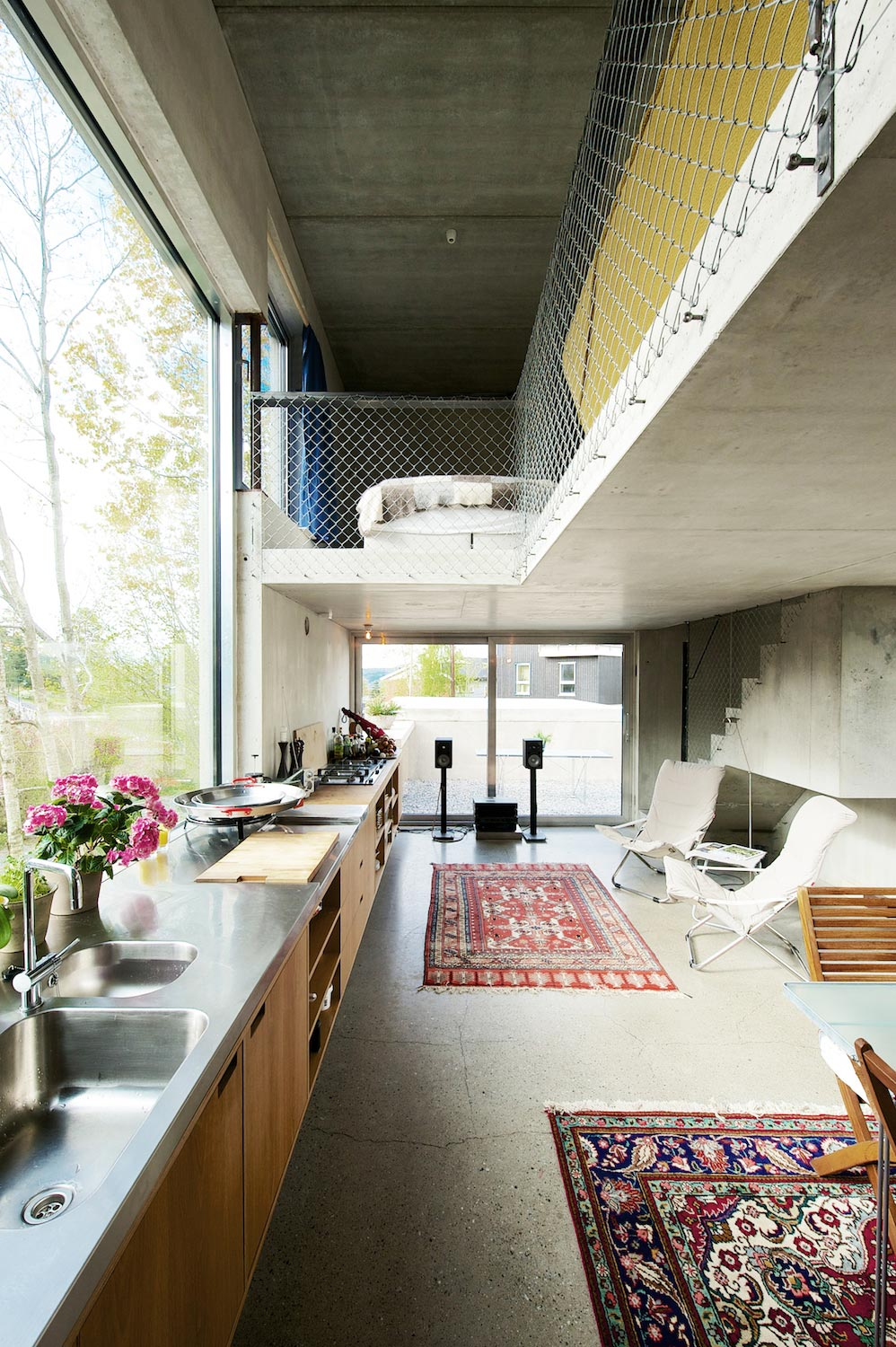 Lie Øyen Arkitekter design the Tussefaret Villa, a little home made by puzzle prefabricated concrete elements