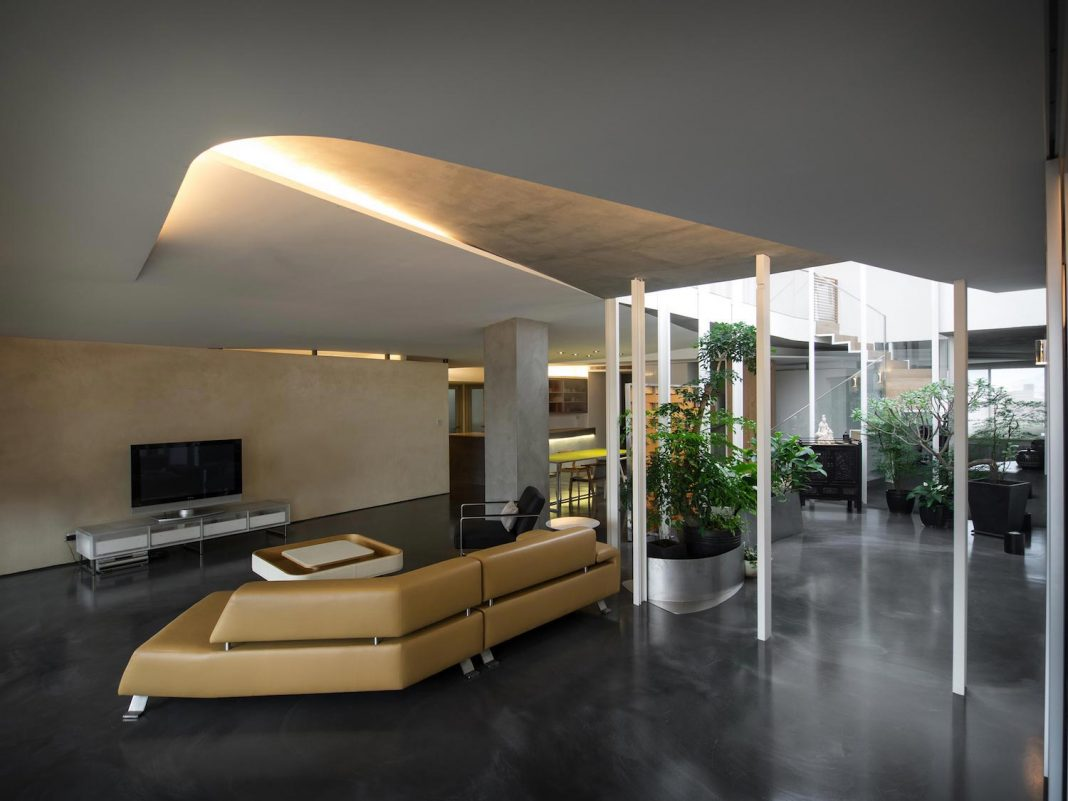 Sky Villa on the top floor of a high rise building in downtown Taipei by CJ Studio