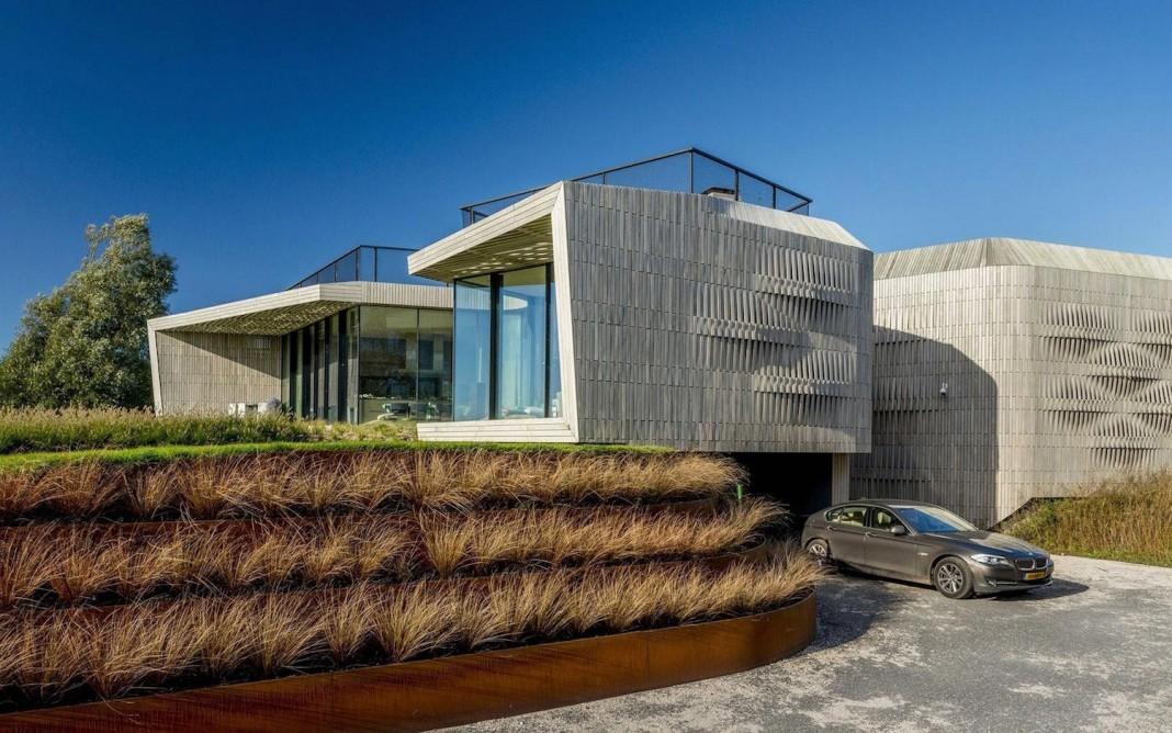 un studio design the w i n d villa a eco friendly netherlands home near the sea caandesign. Black Bedroom Furniture Sets. Home Design Ideas