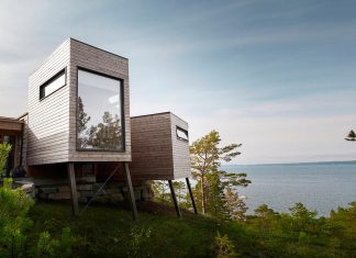 Cabin Straumsnes, a traditional yet modern shelter with a flat gabled roof by Rever & Drage Architects