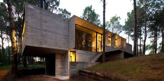 Concrete Valeria House in a lush vegetation and crossed by tall dunes designed by Luciano Kruk and María Victoria Besonías