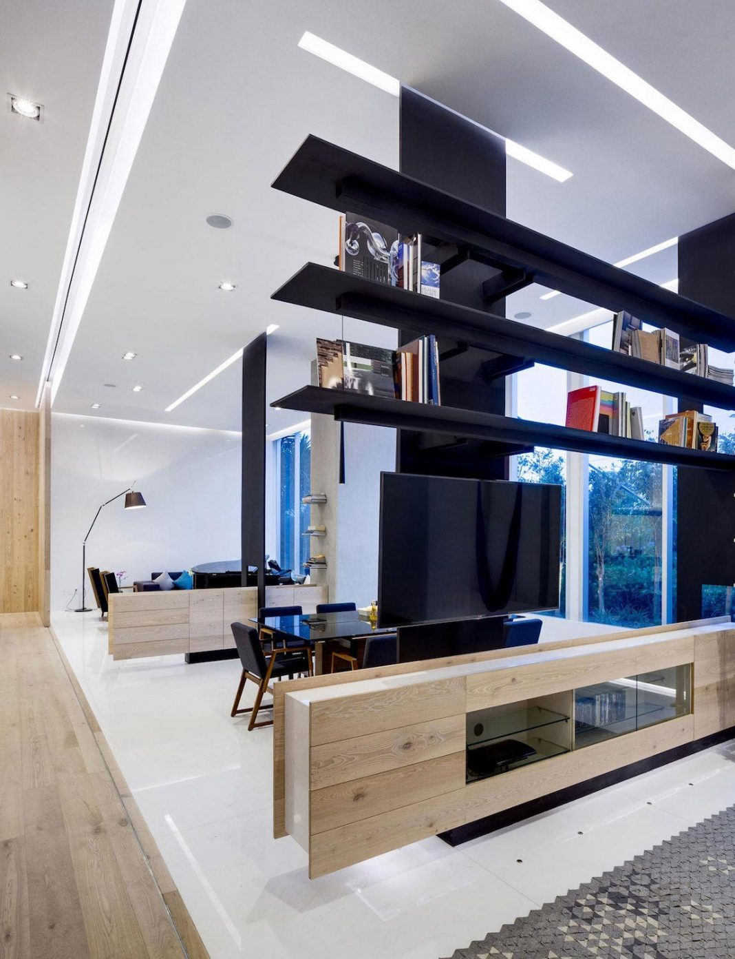 GH Mild clean Apartment with light-toned wood, white stone, and black metalwork by Archetonic