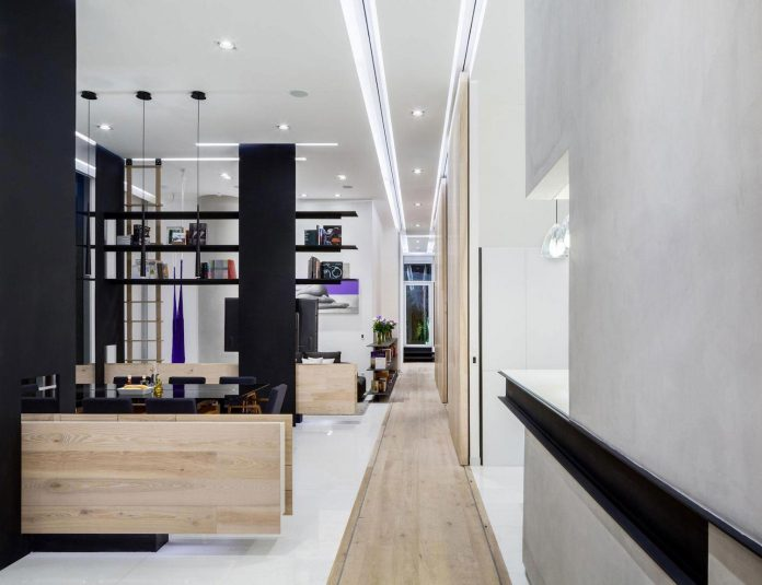 gh-mild-clean-apartment-light-toned-wood-white-stone-black-metalwork-archetonic-06