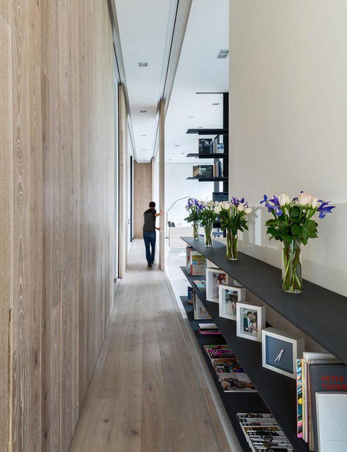 gh-mild-clean-apartment-light-toned-wood-white-stone-black-metalwork-archetonic-13