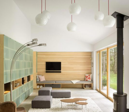 GO Logic design the Cousins River Wooden Residence near a pine forest in southern Maine