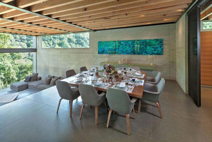 grupoarquitectura-design-tepozcuautla-house-two-volumes-connected-steel-bridges-glass-floors-beyond-forest-19