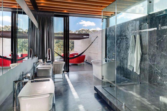 grupoarquitectura-design-tepozcuautla-house-two-volumes-connected-steel-bridges-glass-floors-beyond-forest-23