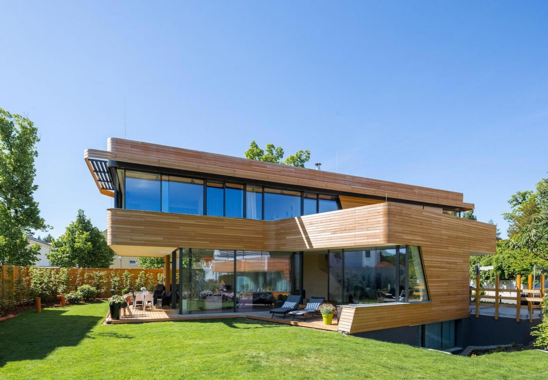 holistic living: eco-friendly wooden single-family house and two
