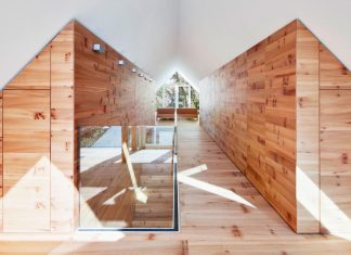 House K bright interior design made up by wood and white walls and ceiling in Düsseldorf by Architekten Wannenmacher and Möller GmbH