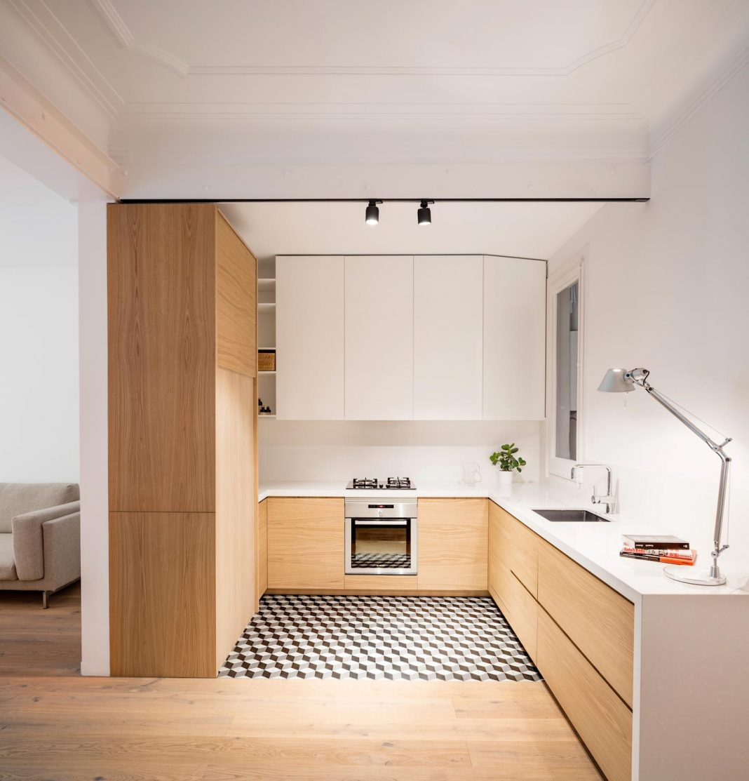 Light wood and white define Alan's Apartment Renovation by Adrian Elizalde
