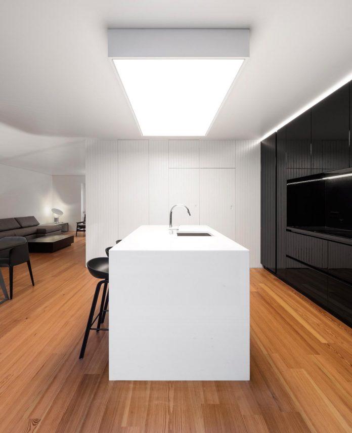 restelo-house-rear-made-series-windows-shutters-resembling-pattern-traditional-portuguese-tiles-joao-tiago-aguiar-08