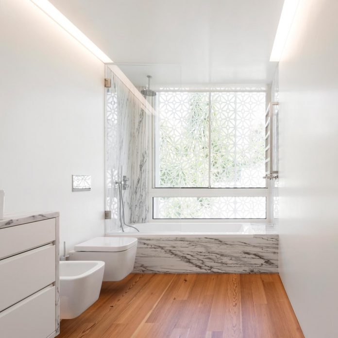 restelo-house-rear-made-series-windows-shutters-resembling-pattern-traditional-portuguese-tiles-joao-tiago-aguiar-10