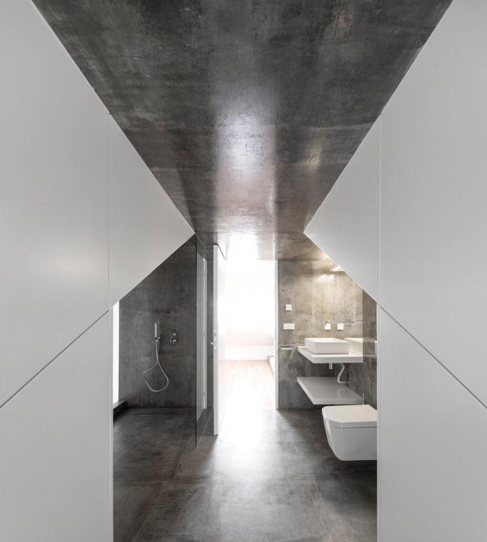 restelo-house-rear-made-series-windows-shutters-resembling-pattern-traditional-portuguese-tiles-joao-tiago-aguiar-15