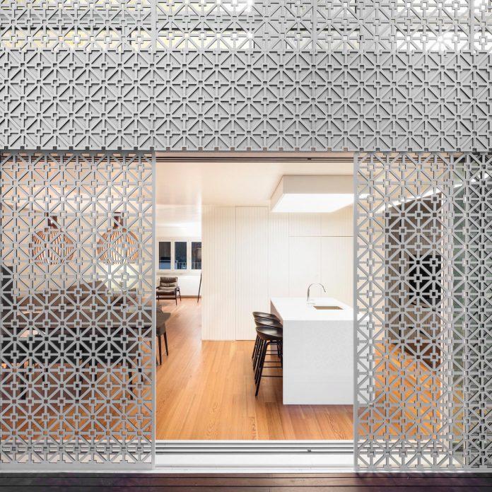 restelo-house-rear-made-series-windows-shutters-resembling-pattern-traditional-portuguese-tiles-joao-tiago-aguiar-17