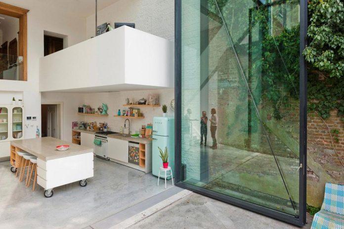 sculpit-design-town-house-antwerp-worlds-largest-pivoting-window-06