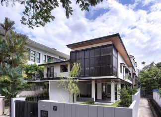 Two story House with Screens in Singapore by ADX Architects