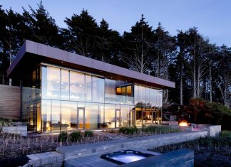 360 House perched above the beach at the edge of the tree line by Bora Architects