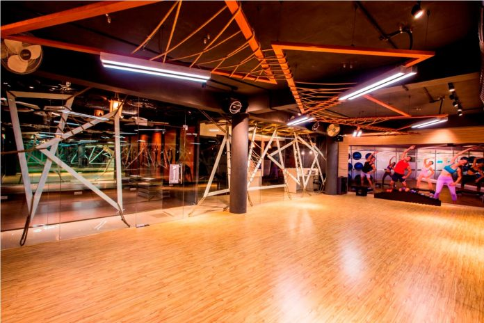 Moksha fitness and spa with overlapping and free standing triangular metal frames, crisscrossed with ropes, designed by Studio Ardete-07
