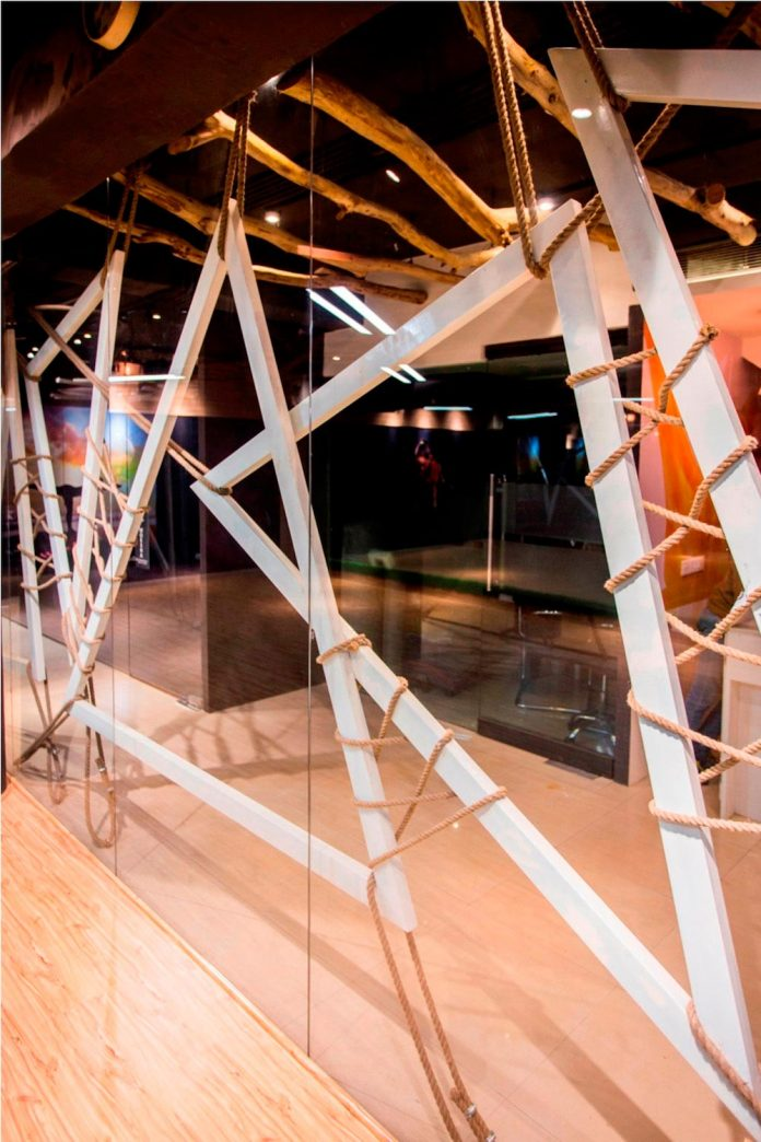 Moksha fitness and spa with overlapping and free standing triangular metal frames, crisscrossed with ropes, designed by Studio Ardete-10