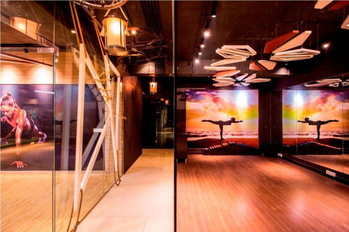 Moksha fitness and spa with overlapping and free standing triangular metal frames, crisscrossed with ropes, designed by Studio Ardete-11