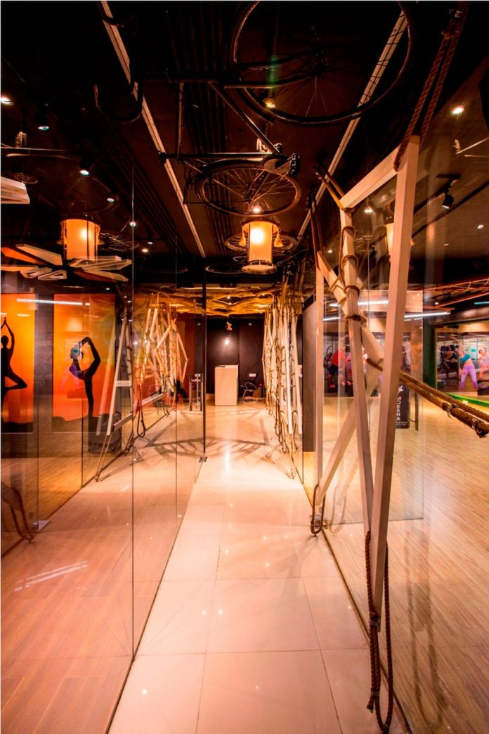 Moksha fitness and spa with overlapping and free standing triangular metal frames, crisscrossed with ropes, designed by Studio Ardete-12