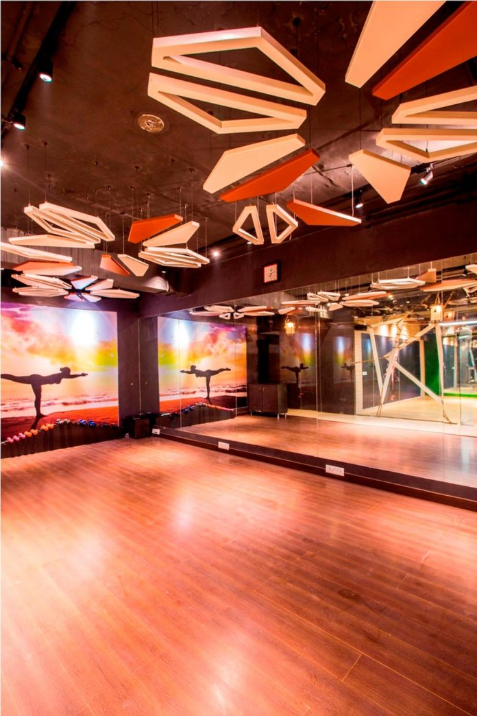 Moksha fitness and spa with overlapping and free standing triangular metal frames, crisscrossed with ropes, designed by Studio Ardete-21