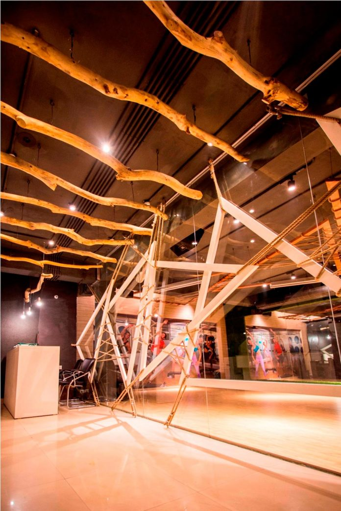 Moksha fitness and spa with overlapping and free standing triangular metal frames, crisscrossed with ropes, designed by Studio Ardete-22