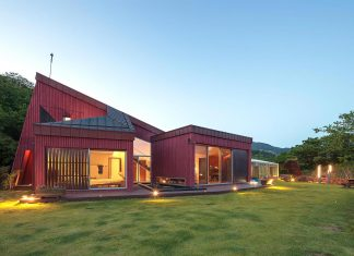 Bang Keun YOU design the Jirisan House: a red home in harmony with the natural earth toned materials